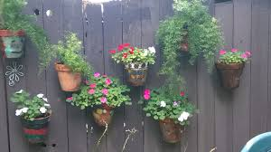 planters that hang on the wall fence hanging planters fence flower pots flower pot holders