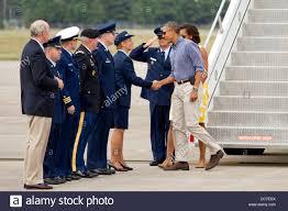 us president barack obama greets base commanders after landing