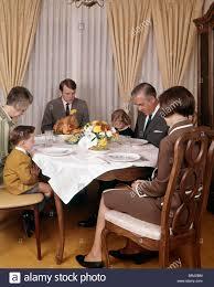 1960s 1970s three generation family saying grace prayer thanksgiving