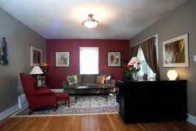 cream walls with red accent wall bedroom design ideas