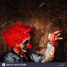 halloween blood background evil halloween clown with big scary needle performing sinister