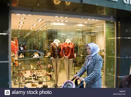 woman walking past women u0027s clothes shop in nisantasi istanbul