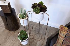 set of 3 industrial modern triangle planter stands with gray clay