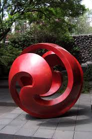 landscape a swirling design garden sculptures statues rocking