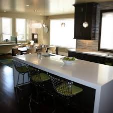 decor bar stools and waterfall countertop with pendant lighting
