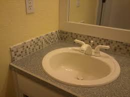 bathroom sink backsplash ideas white oval undermount sink with two handle mixer tap also concrete