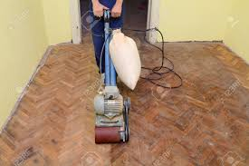 worker polishing parquet floor with machine stock