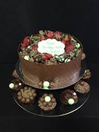 black chocolate ganache 1st birthday cake made by sweetsbysuzie in