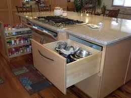 satisfied customers kitchens design colorado springs also the island note large drawers where kathy keeps her pots and pans over left cooktop have pull out for many essential