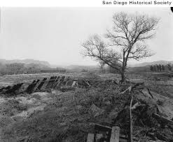 calisphere railroad tracks wrapped around a tree after the 1916 flood