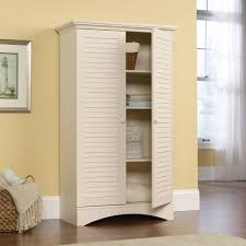 Tall White Bookcase With Doors by Furniture Tall White Wood Bookcase With Shutter Pattern Swinging