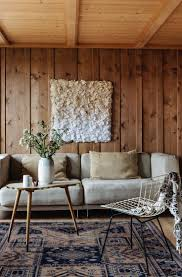 paneling living room hypnotizing wood frame sofa and white wall paneling