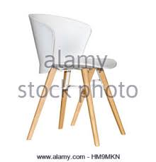 White Plastic Kitchen Chairs - retro modern white plastic chair and table stock photo royalty