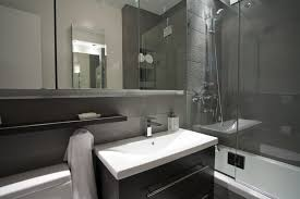 modern small bathroom design with drop in tub and wall mounted
