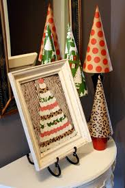 Mantel Topiaries - 52 mantels wrapping paper christmas tree topiaries