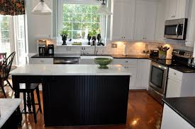 Carrara Marble Kitchen by Countertops In Carrara Marble Honed Finish And Black Pearl Granite