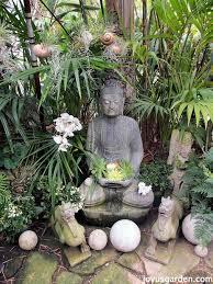 an enchanted balinese style garden us gardenjoy us garden