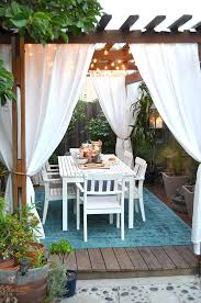 Outdoor Winter Curtains How To Plan And Hang Patio Lights Patio Lighting Pergolas And