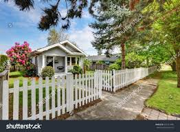 cute craftsman home exterior picket fence stock photo 520117405