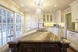 decorating crystal chandelier with cosmos granite countertop also