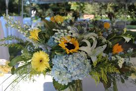 blue centerpieces vase centerpieces yellow blue barteesflowers