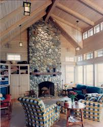 seattle river rock fireplace living room traditional with cupboard