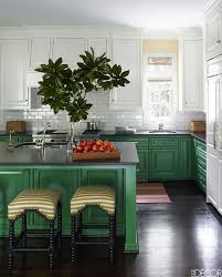 green kitchen cabinets with white island ask about kitchen cabinet uppers and lowers in