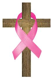 breast cancer ribbon on cross on biceps
