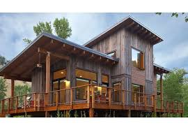 shed roof houses exterior view of the home with wrap around deck contemporary