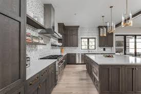 gray brown stained kitchen cabinets white and gray marble herringbone tiles with brown