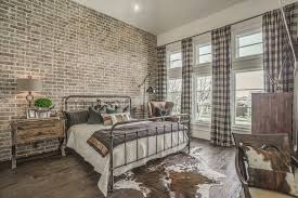 austin muted colors bedroom rustic with iron bedframe table lamps