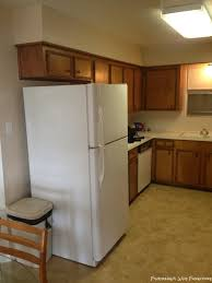 gap between fridge and cabinets fisherman s wife furniture covering fur down the space above the