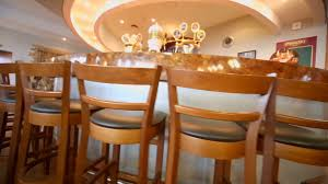 two chairs stand near bar counter in small cafe bar stock video