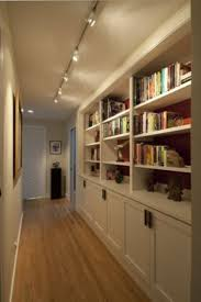 provocative hallway interior design idea with bookshelf also