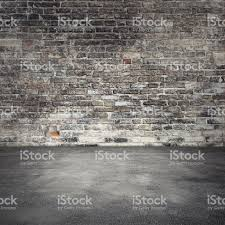 background with dark old brick wall and asphalt stock photo