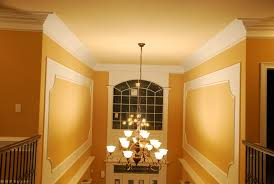 decor dark pergo flooring with wainscoting panels and beige
