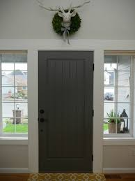 painted front door with benjamin moore kendall charcoal wall