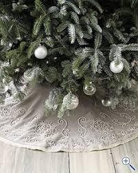 white tree skirt living in white snowflake