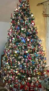 omg lovely mix of vintage ornaments on this fashioned tree