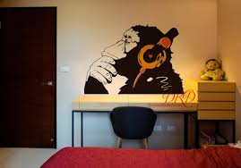 banksy monkey with headphones wall art banksy chimp head