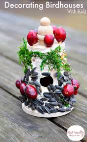 decorating birdhouses with edible bird seed glue craft