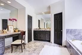 black bathroom vanity with black marble tub contemporary bathroom