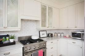 antiqued mirrored kitchen cabinet doors transitional kitchen