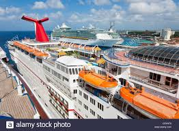 royalcaribbean carnival ecstasy and two royal caribbean cruise ships at port in