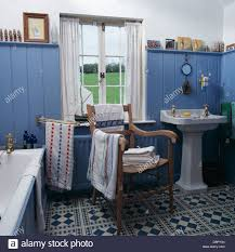 blue tongue groove paneled walls and blue white tiled floor in