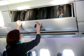 United Airlines International Baggage Allowance by United Airlines Will Begin Charging To Use Overhead Bins In 2017