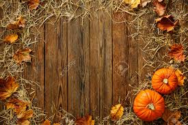 harvest or thanksgiving background with gourds and straw on a