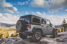 muddy jeep prepping for overland off roading with the jeep wrangler the