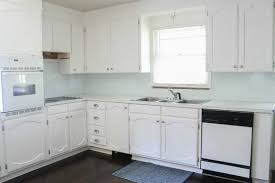 how to paint stained kitchen cabinets white painting oak cabinets white an amazing transformation