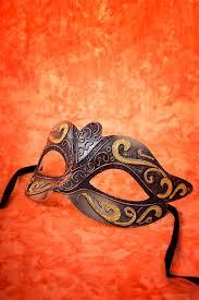 orange mardi gras mardi gras mask on orange background stock photo image of gold